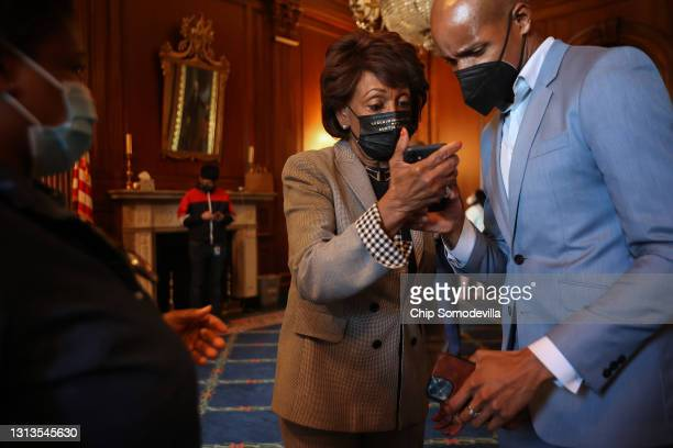 Rep. Maxine Waters watches the announcement of the verdict in the Derek Chauvin murder trial on her phone in the Rayburn Room at the U.S. Capitol on...