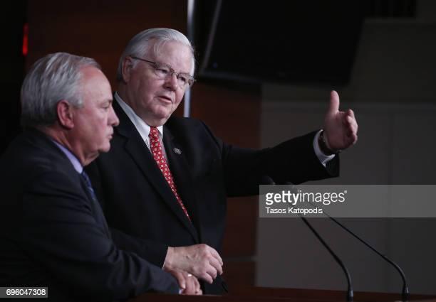 S Rep Michael Doyle and US Rep Joe Barton both congressional baseball team coaches speak on Capital Hill on June 14 2017 in Washington DC Rep Barton...
