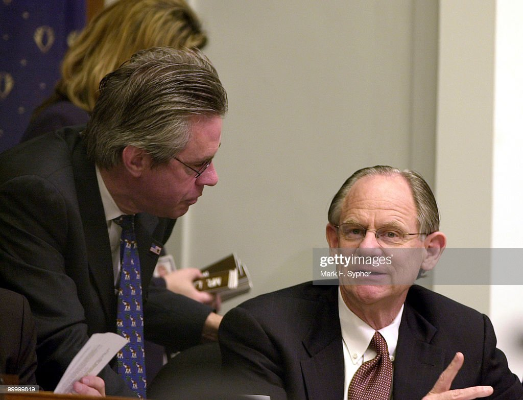 Rep. Michael N. Castle (R-DE) consults aides during a Financial Services hearing in which Alan Greenspan testified.