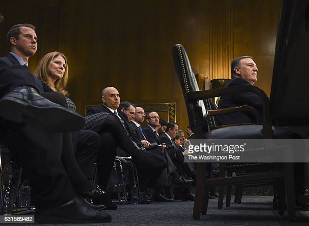 Rep Michael Pompeo listens to questioning with his wife Susan and son Nicholas left seated behind him before the Senate Intelligence Committee...