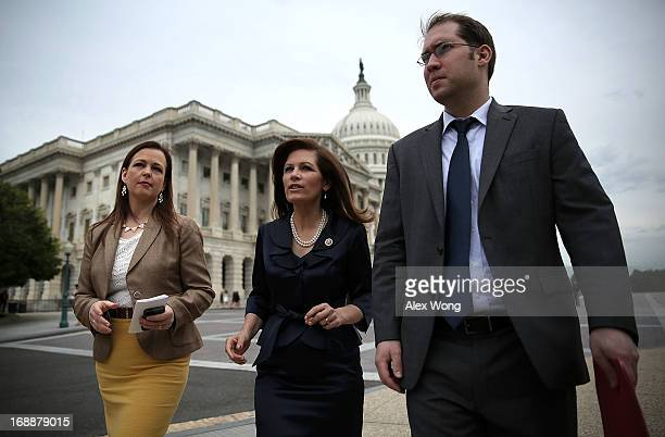 Rep. Michele Bachmann and co-founder and CEO of Tea Party Patriots Jenny Beth Martin arrive at a news conference May 16, 2013 on Capitol Hill in...