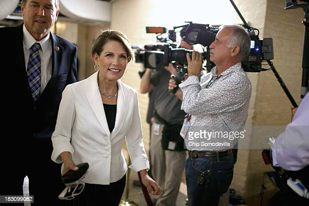 """Rep. Michele Bachmann heads for a House Republican caucus meeting at the U.S. Capitol October 4, 2013 in Washington, DC. """"This isn't some damn game,""""..."""