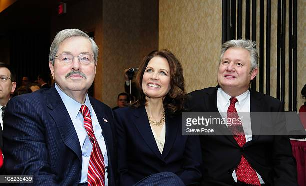 Rep Michele Bachmann her husband Marcus Bachmann and Iowa Gov Terry Branstad listens to Bachmann's introduction prior to her speach at the Iowans for...