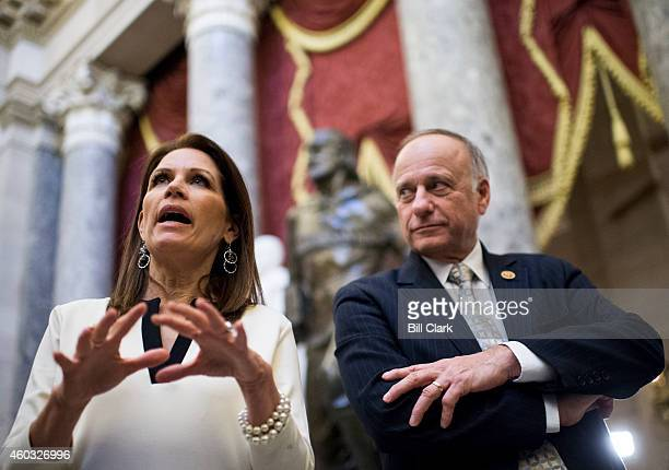 Rep. Michele Bachmann, R-Minn., and Rep. Steve King, R-Iowa, speak to reporters in Statuary Hall in the U.S. Capitol on Thursday, Dec. 11 as House...