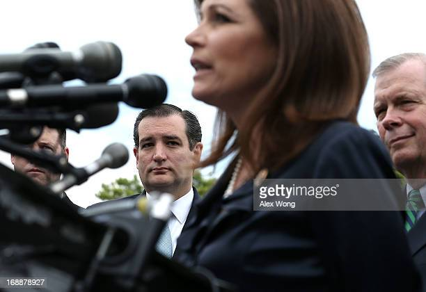 Rep. Michele Bachmann speaks as Sen. Ted Cruz listens during a news conference May 16, 2013 on Capitol Hill in Washington, DC. Bachmann held a news...