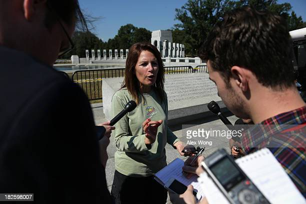 Rep. Michele Bachmann speaks to members of the media outside the World War II Memorial during a government shutdown October 1, 2013 in Washington,...
