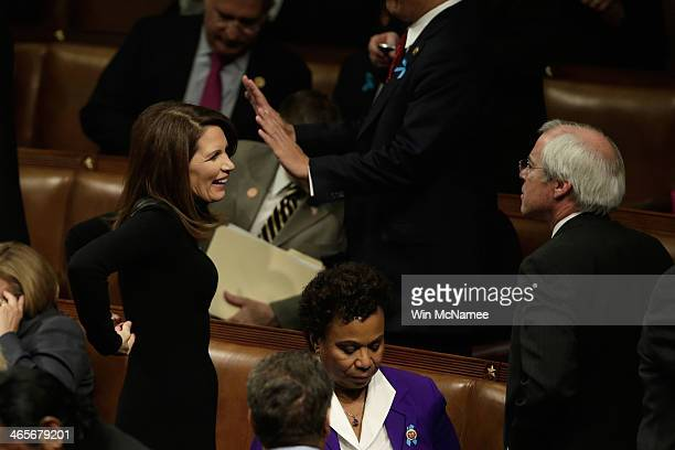 Rep. Michele Bachmann waits for U.S. President Barack Obama to deliver the State of the Union address to a joint session of Congress in the House...