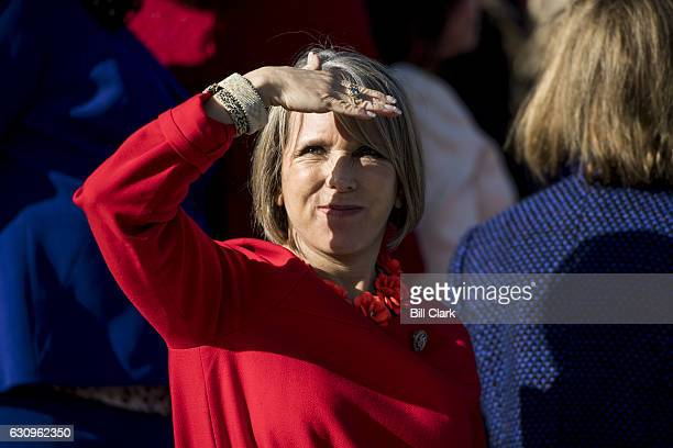 Rep Michelle Lujan Grisham DNM along with the other House Democratic women wait on the House steps for House Minority Leader Nancy Pelosi DCalif to...