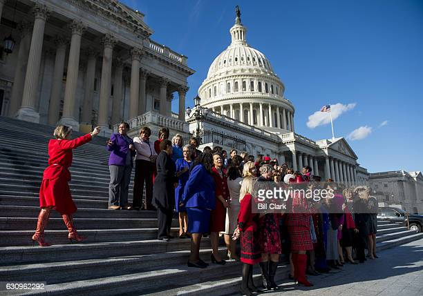 Rep Michelle Lujan Grisham DNM left arrives for the photoop on the House steps with House Minority Leader Nancy Pelosi DCalif and the other...