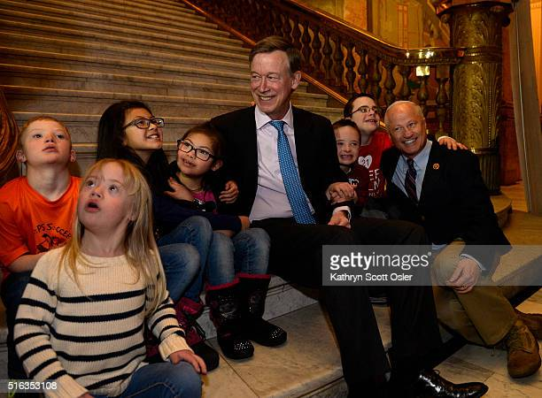 S Rep Mike Coffman right and Gov John Hickenlooper gather on the steps of the capitol rotunda to have a group photo taken with some of the kids...