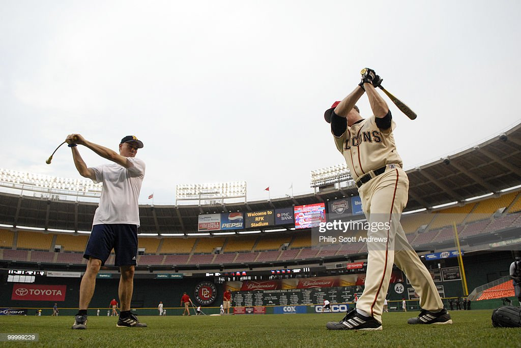 Rep. Mike Conaway, R-Tx, takes a few practice swings to warm up before the start of the game.