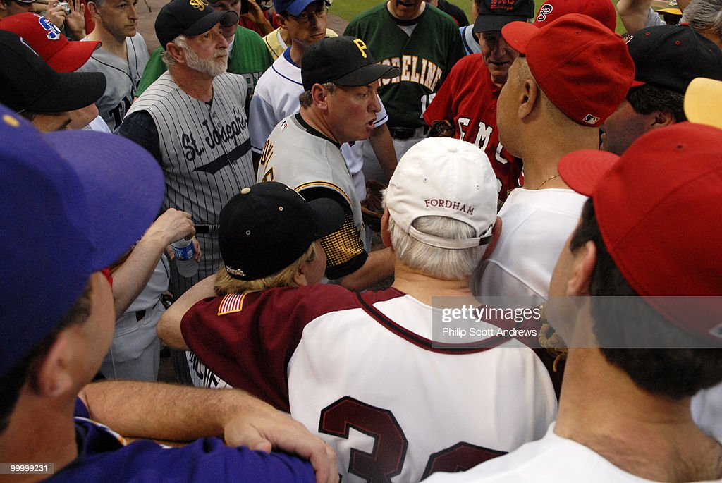 Rep. Mike Doyle-D, Pa, the manager of the Democrats, talks to his team before the start of the game. Doyle lead the Dems to his second consecutive managerial loss.