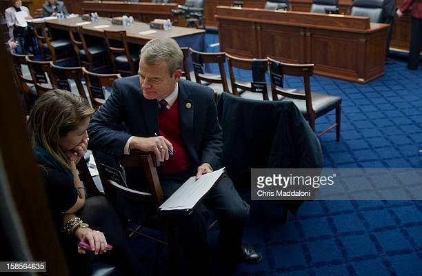 Rep Mike McIntyre DNC speaks with aide Genevieve Fugere before a House Armed Services committee hearing on 'Update on the Evolving Security Situation...