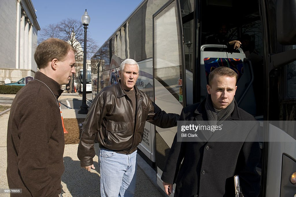 Rep. Mike Pence, R-Ind., boards one of four buses for the ride to the House Republican retreat on Thursday, Jan. 29, 2009.