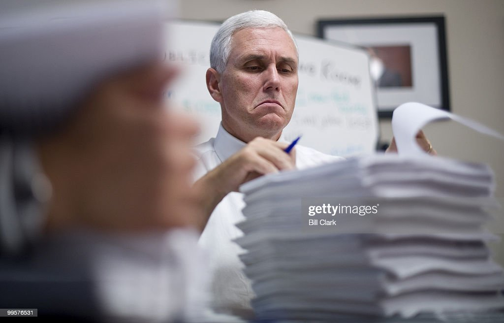 Rep. Mike Pence, R-Ind., makes marks on the House health care bill as House Republicans gathered in the House Republicans Reading Room in the Longworth House Office Building on Tuesday, Nov. 3, 2009.