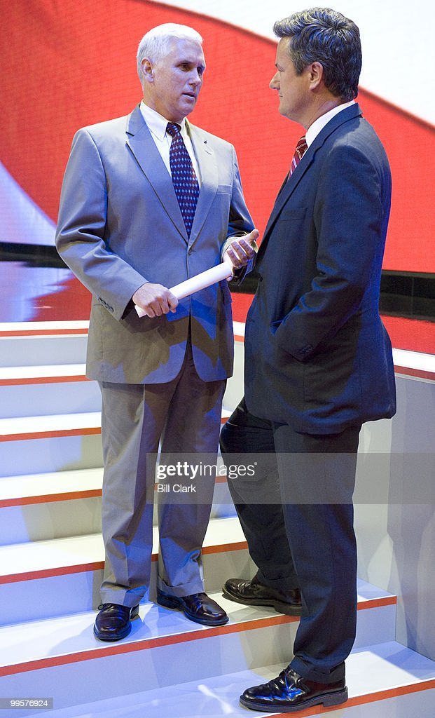 Rep. Mike Pence, R-Ind., speaks with MSNBC's Joe Scarborough on the stage steps after his stage walk though at the Republican National Convention at the Xcel Center in St. Paul, Minn., on Tuesday, Sept. 2, 2008.