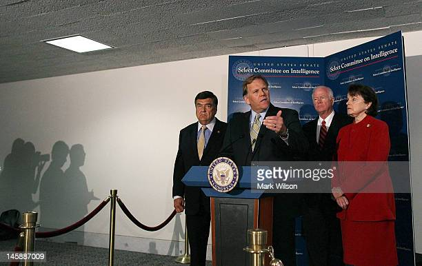 S Rep Mike Rogers speaks to the media while flanked by US Rep Dutch Ruppersberger US Sen Saxby Chambliss and US Sen Dianne Feinstein after a closed...
