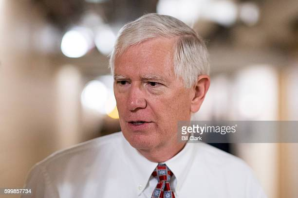 Rep. Mo Brooks, R-Ala., speaks with reporters as he leaves the House Republican Conference meeting in the Capitol on Wednesday morning, Sept. 7, 2016.