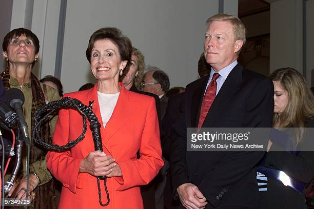 Rep Nancy Pelosi holds a symbol of her office as she stands with Minority Leader Dick Gephardt after she was elected House whip in Washington today