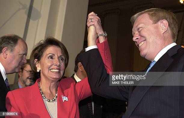 Rep Nancy Pelosi newly elected Democratic Minority Leader raises her hand with outgoing leader Dick Gephardt 14 November 2002 on Capitol Hill in...