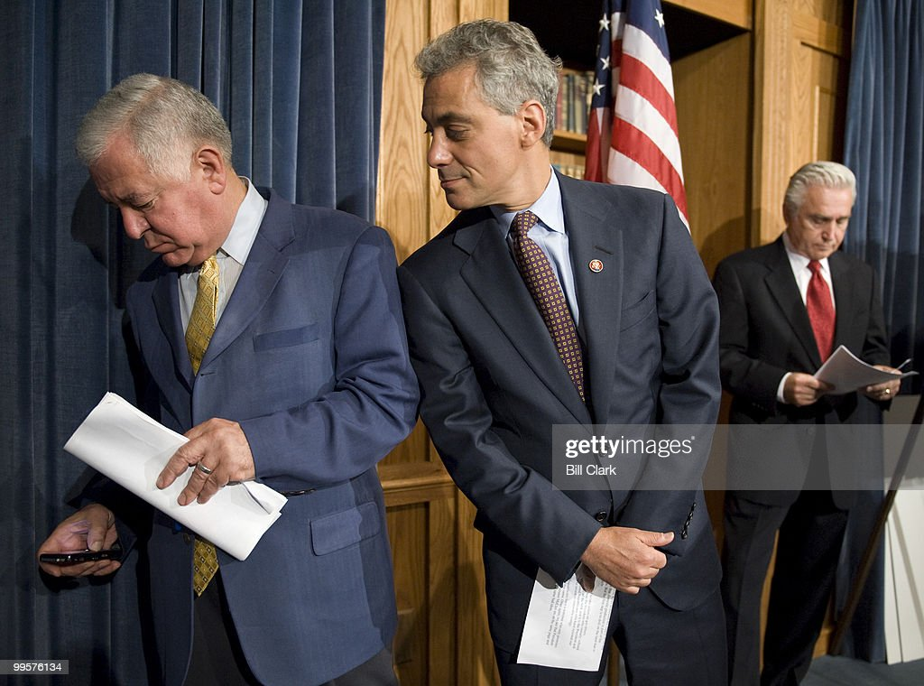 Rep. Nick Rahall, D- W.Va., tries to silence the speaker phone feature on his Blackberry as Rep. Rahm Emanuel, D-Ill., watches during the Democrats' news conference on off-shore oil drilling on Wednesday, June 18, 2008. The Blackberry played voicemail instructions until Rep. Emanuel finally reached over to shut off the speaker phone.
