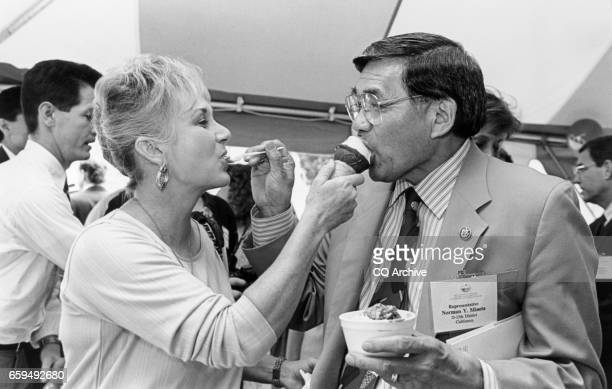 Rep Norman Mineta DCalif and wife Danealia feeding each other ice cream at Russel Courtyard on June 26 1995