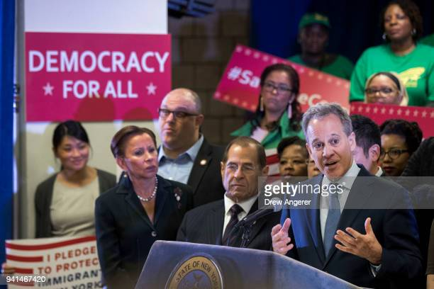 US Rep Nydia Velazquez and US Rep Jerrold Nadler look on as New York Attorney General Eric Schneiderman speaks at a press conference to announce a...