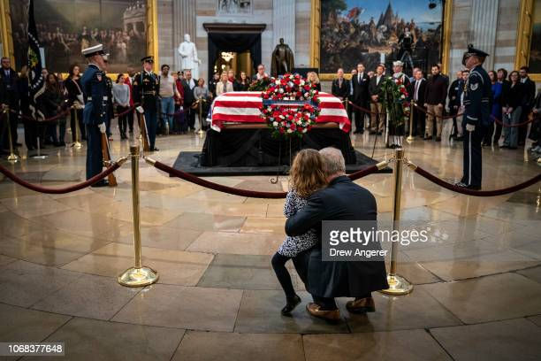 Rep Patrick McHenry and his daughter Cecilia pay their respects at the casket of the late former President George HW Bush as he lies in state at the...