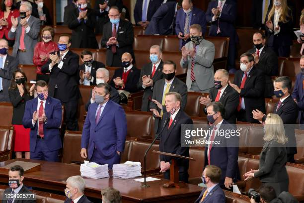 Rep. Paul Gosar and Sen. Ted Cruz are applauded by Republican members of Congress after they objected to the certification of the electoral votes for...