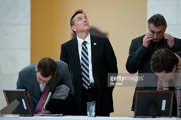 Rep Paul Gosar RAriz prepares to write in the books well wishes and condolences for Rep Gabrielle Giffords in the Cannon Rotunda on Wednesday Jan 12...