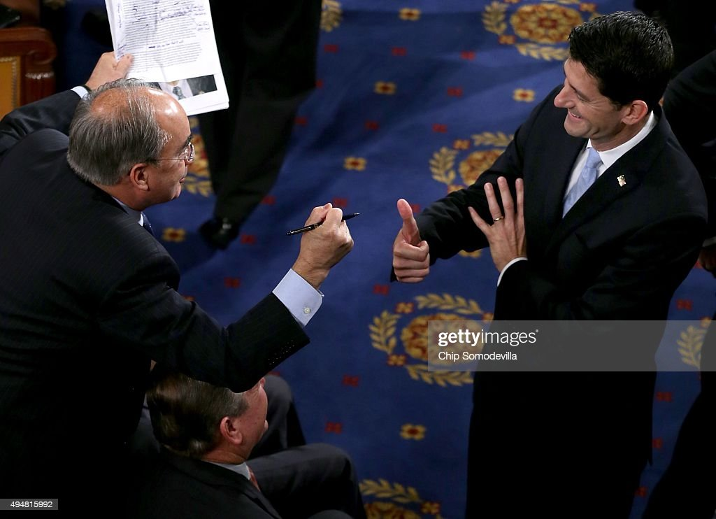 U.S. Rep. Paul Ryan (R-WI) (R) gives a thumbs up to Rep. Bruce Poliquin (R-ME) (L) in the House Chamber of the Capitol October 29, 2015 on Capitol Hill in Washington, DC. The House of Representatives is scheduled to vote for a new speaker to succeed Rep. John Boehner (R-OH) today.