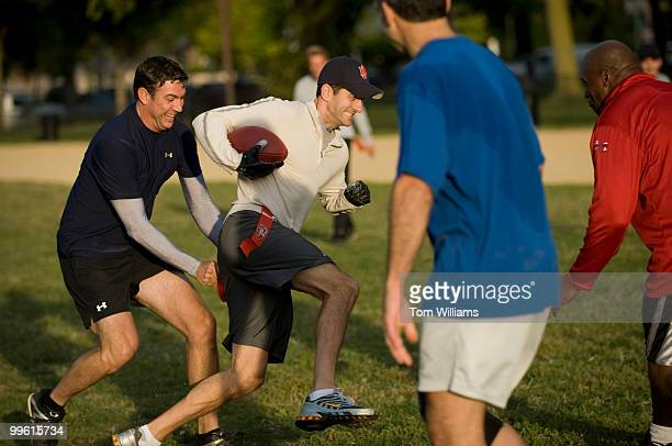 Rep Paul Ryan RWic tries to evade defender Rep Duncan Hunter RCalif during a flag football practice on the Mall Oct 8 in preparation for the upcoming...