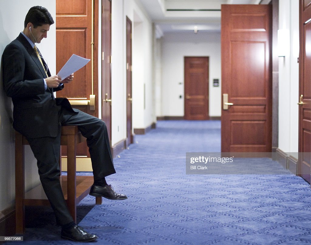 Rep. Paul Ryan, R-Wisc., looks over papers as he waits for other House Republicans to arrive for a news conference in the Capitol Visitors Center on road map to America's Future 2.0, on Wednesday, jan. 27. 2010.