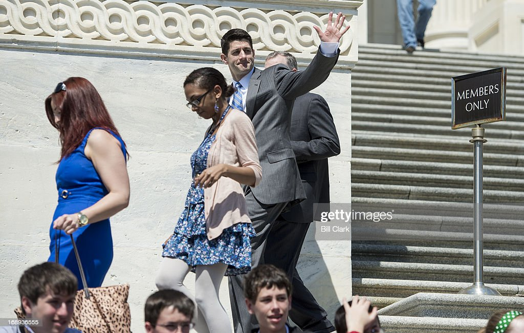 Rep. Paul Ryan, R-Wisc., waves as a group of tourists shout his name as he walks down the House steps after a series of votes in the House of Representatives on Friday, May 17, 2013.