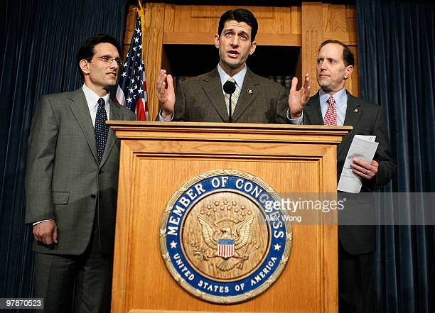 S Rep Paul Ryan speaks as Rep Dave Camp and House Minority Whip Rep Eric Cantor look on during a news conference on the health care legislation March...