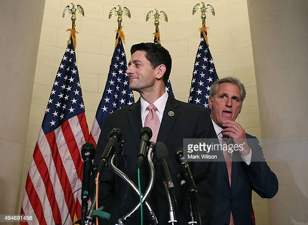Rep Paul Ryan speaks to the media while flanked by House Majority Leader Kevin McCarthy after House Republicans nominated him to be the next Speaker...