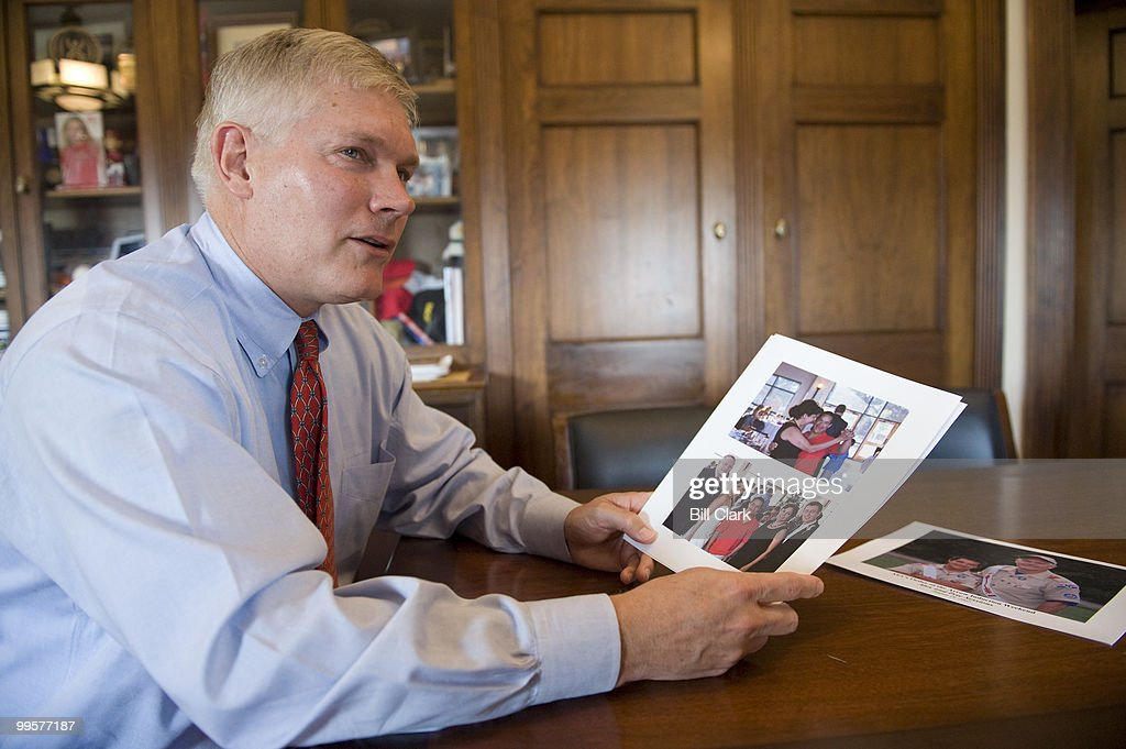 Rep. Pete Sessions, R-Texas, shows off photos of his son Alex, who has Down Syndrome, in his Longworth office on Wednesday, Sept. 10, 2008.