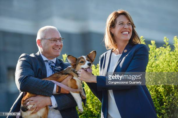 Rep Pete Stauber RMinn left and Rep Cindy Axne DIowa hold a dog during a news conference about calling for the passage of federal animal cruelty law...