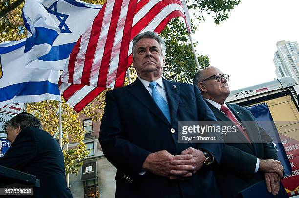 S Rep Peter King and former New York City Mayor Rudy Giuliani stand before a group of protestors outside the Metropolitan Opera at Lincoln Center on...
