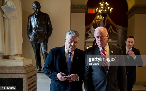 Rep Peter King RNY left and Rep Pat Meehan RPa right talk as they head to the House chamber as Congress prepares to vote on defunding President...