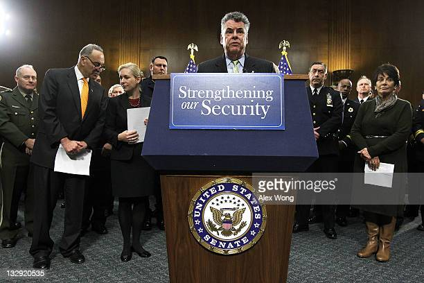 S Rep Peter King speaks as Sen Kirsten Gillibrand talks to Sen Charles Schumer and Rep Anna Eshoo looks on during a news conference November 15 2011...