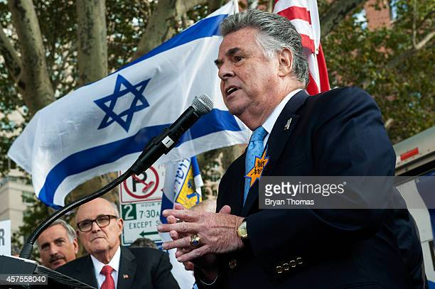 S Rep Peter King speaks before a group of protestors outside the Metropolitan Opera at Lincoln Center on opening night of the opera The Death of...