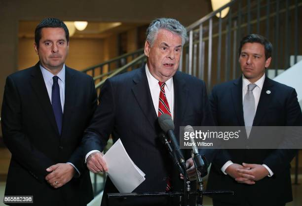Rep Peter King speaks while flanked by Rep Don DeSantis and House Intelligence Committee Chairman Devin Nunes as they announce that the House...