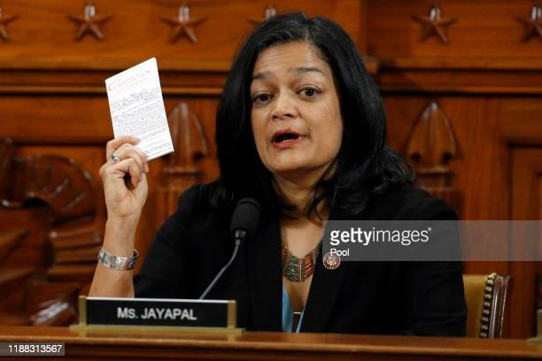 Rep. Pramila Jayapal, D-Wash., holds up a copy of the U.S. Constitution as she votes yes to the second article of impeachment as the House Judiciary...