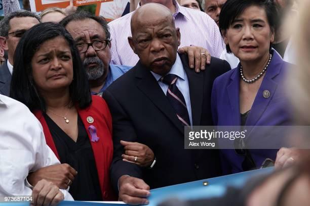 US Rep Pramila Jayapal Rep Raul Grijalva Rep John Lewis and Rep Judy Chu march to the headquarters of US Customs and Border Protection during a...
