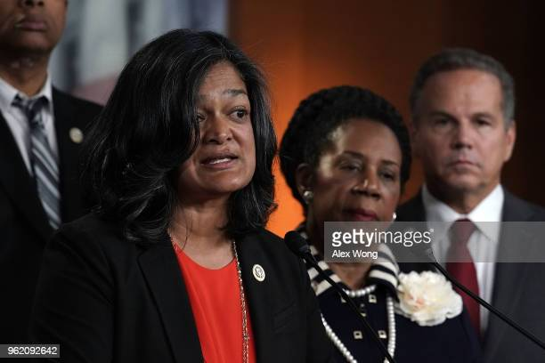 Rep. Pramila Jayapal speaks as Rep. Sheila Jackson Lee and Rep. David Ciclline listen during a news conference to denounce a meeting between the...