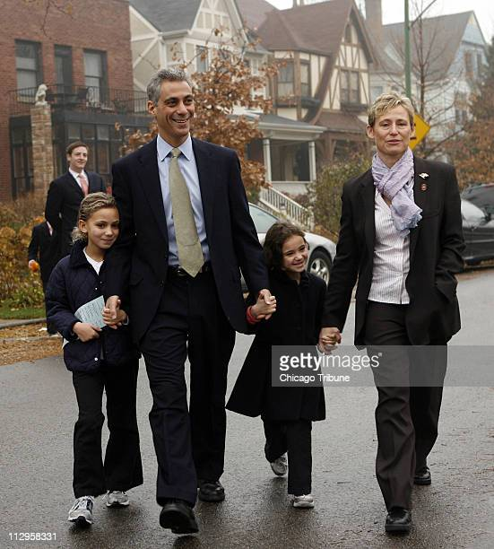 US Rep Rahm Emanuel walks with his family daughters Ilana left and Leah and wife Amy Rule as they head to a polling place in Chicago Illinois on...