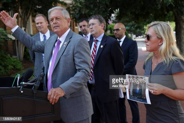 Rep. Ralph Norman speaks as Rep. Marjorie Taylor Greene and Rep. Thomas Massie listen during a news conference outside U.S. Supreme Court on July 27,...