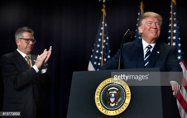 Rep Randy Hultgren claps as President Donald Trump speaks at the National Prayer Breakfast on February 8 2018 in Washington DC Thousands from around...