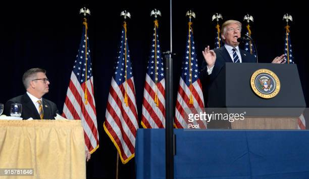 Rep Randy Hultgren listens as President Donald Trump speaks at the National Prayer Breakfast on February 8 2018 in Washington DC Thousands from...